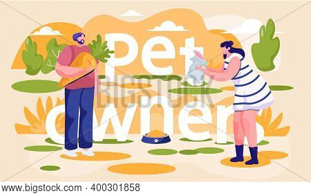 Girl Plays With Rabbit. Man Holding A Carrot For An Animal. Guy Is Feeding The Little Hare. Young Pe