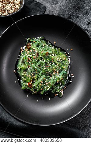 Healthy Seaweed Chuka Salad With Greens. Black Background. Top View