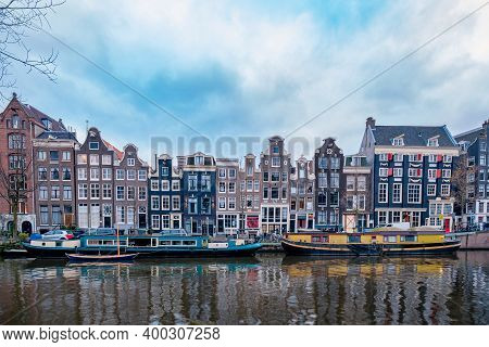 Amsterdam Canals Netherlands, Amsterdam Holland During Sunset Evening During Wintertime In The Nethe