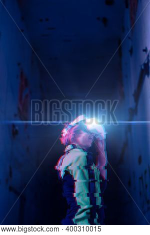 Woman Goes Into Virtual Reality Using Virtual Reality Headset. Image With Glitch Effect. The Concept