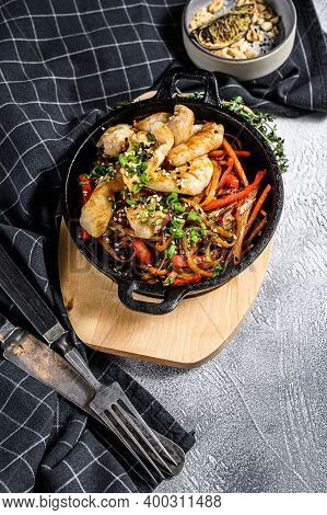 Udon Stir Fry Noodles With Chicken And Vegetables In Pan. Gray Background. Top View