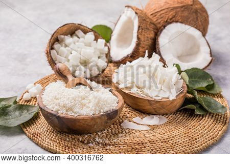 Whole And Broken Coconut With Grated Coconut Flakes, Chips, Cubes.coconut Fruit And Shredded Coconut