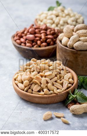 Roasted Salted Peanuts. Crispy Nuts In Bowl On Stone Table.salted And Roasted Peanuts Closeup, Snack