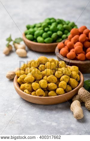 Assortment Of Different Peanuts Snack For Beer, Wine, Party Bar. Salted Peanuts, Green Vasabi, Red S