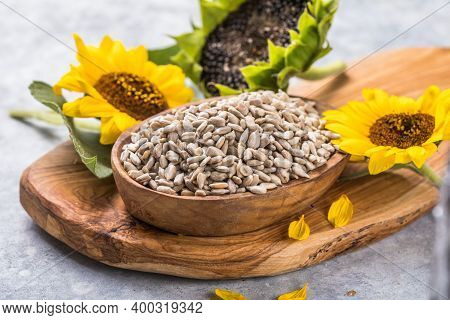 Sunflower Seeds In A Small Plate With Sunflower Plant. Healthy Vegetarian Protein Nutritious Food.a