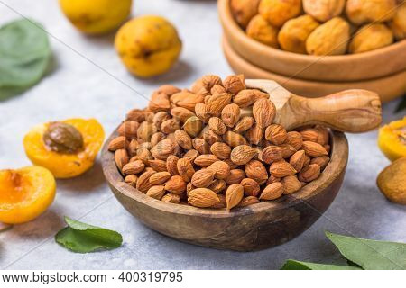 Handful Of Peeled Apricot Kernels On Light Background. An Apricot Kernel Is The Seed Of An Apricot,