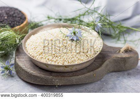 White Cumin Seeds Or Sesame With Nigella Sativa Flower On White Background. Black Cumin Seeds Essent