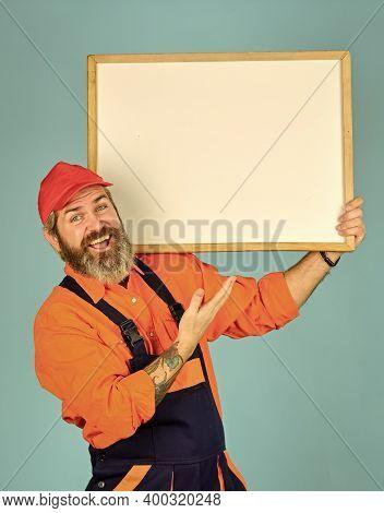 Housekeeping Company. Mechanic Perform Technical Work. Repairman Worker. Man Worker Hold Chalkboard