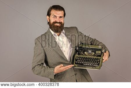 Writer Writes With Typewriter. Bearded Man In Jacket With Retro Type Writer. New Technology In Moder