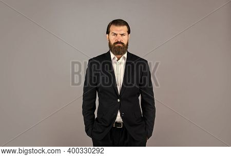 Looking Trendy. Handsome Man Standing On Gray Background. Serious Bearded Businessman. Stylish Matur