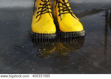The Color Of The Year 2021 Is Illuminating Yellow And The Ultimate Gray.  Bright Yellow Rubber Boots
