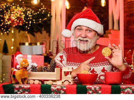 Senior Man Santa Claus Drinking Tea. Cozy Atmosphere. Cozy Home. Christmas Eve Treats. Christmas Coc