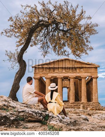 Couple Watching Old Temple During A Vacation At The Italian Island Sicily Visiting The Archeological