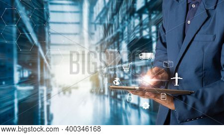 Businessman Works With Financial Data. Futuristic Interface Above Laptop Computer. Interactive Busin