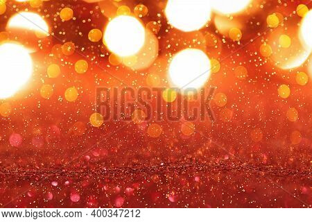 Abstract Red Glitter Christmas Background With Golden Lights