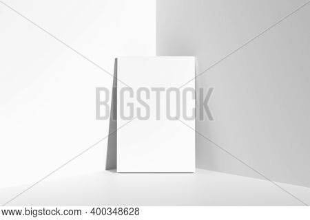 Blank White Empty Rectangular Poster On Floor Leaning At Empty White Walls In Cornet, White Bleached