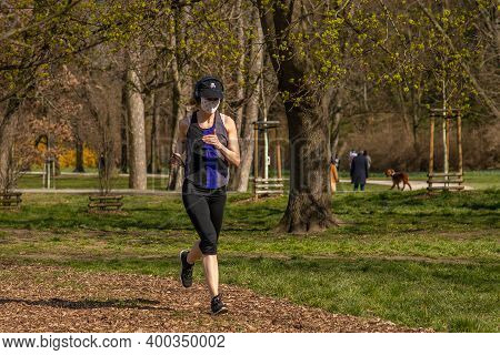 Prague, Czech Republic. 03-11-2020. Woman Running In Park Stromovka. Covid-19 It Is A World Spread P