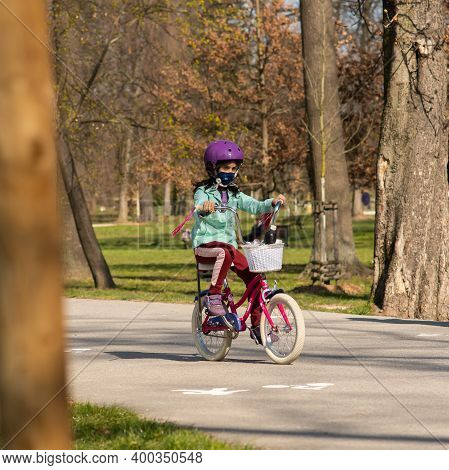 Prague, Czech Republic. 03-11-2020. Young Girl Riding On Bike In Park Stromovka. Covid-19 It Is A Wo
