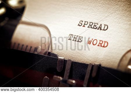 Spread the word phrase written with a typewriter.