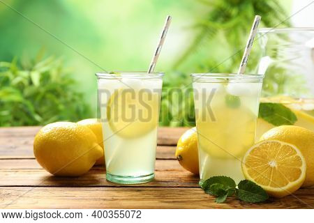 Natural Lemonade With Mint On Wooden Table. Summer Refreshing Drink