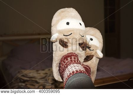 Slippers On Female Legs. Soft Comfortable Slippers. Cozy House Slippers In The Shape Of A Bull, Cow,