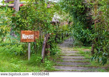 Sign At The Entrance With The Inscription Namaste, This Word Translated From Sanskrit Means