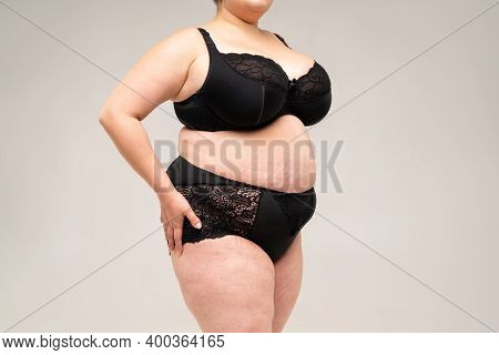 Fat Woman In Black Lingerie, Overweight Female Body On Gray Background