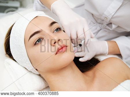 Woman Getting Cosmetic. Injection. Beauty Injections And Cosmetology.  Young Woman In Beauty Salon S