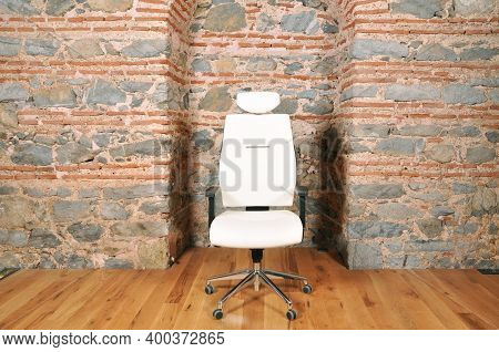 Comfortable And Stylishly Designed White Office Chair In Front Of A Wall