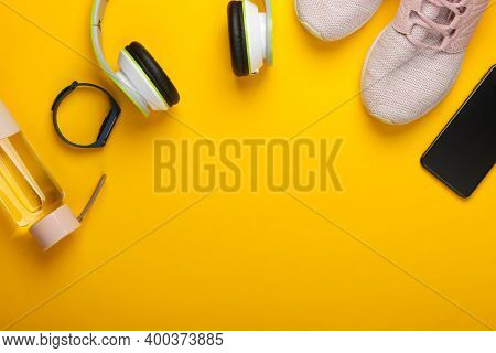 Flat Lay Composition Of Modern Gadgets For Sports And Fitness. Wireless Headphones, Smart Bracelet,