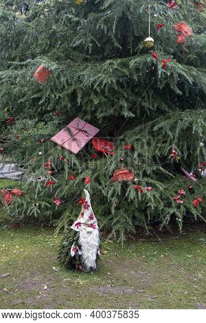 Small Garden Dwarf Made Of Pine Twigs As A Christmas Decoration In A City Park In Opatija, Croatia