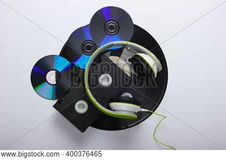 Retro Media. Stereo Headphones, Video Cassettes, Vinyl Records, Audio Cassette, Cd Discs On A White