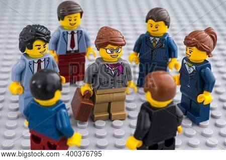 Tambov, Russian Federation - December 19, 2020 Lego Businesspeople Minifigures Standing Around A Bus