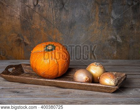 Vegetables Lying On An Oblong Wooden Tray On The Table