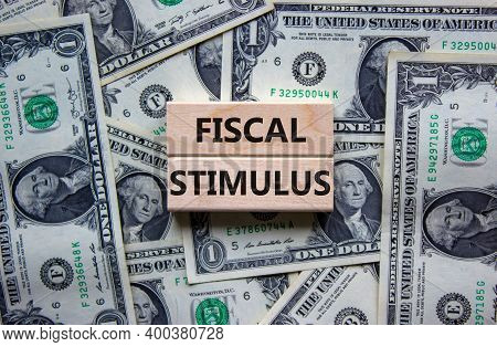 Fiscal Stimulus Symbol. Concept Words 'fiscal Stimulus' On Wooden Blocks On A Beautiful Background F