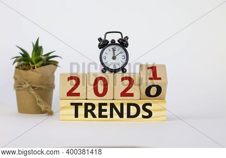 Trends 2021 Symbol. Fliped Wooden Cube And Changed Words 'trends 2020' To 'trends 2021'. Black Alarm
