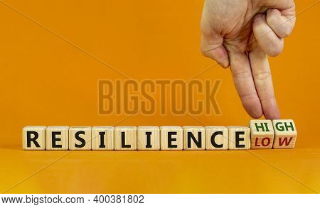 High Or Low Resilience Symbol. Male Hand Flips Wooden Cubes And Changes Words 'resilience Low' To 'r