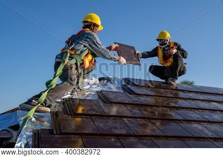 Team Work Construction Worker Install New Ceramic Tile Roof With Roofing Tools Electric Drill Used I