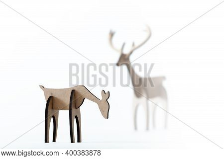 Reindeer Stag And Young Deer Cardboard Toy Isolated On A White Background. Christmas Icon And Shapes