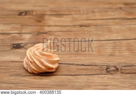 An Orange Meringue On A Wooden  Table
