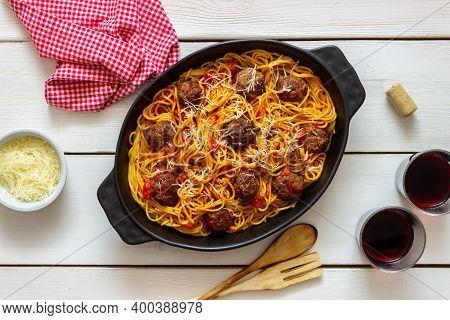 Meatballs With Spaghetti, Tomato Sauce And Parmesan Cheese. Italian Cuisine.