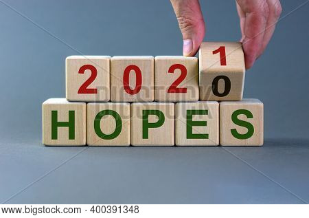 2021 New Year Hopes Symbol. Male Hand Flips A Wooden Cube And Changes The Inscription 'hopes 2020' T