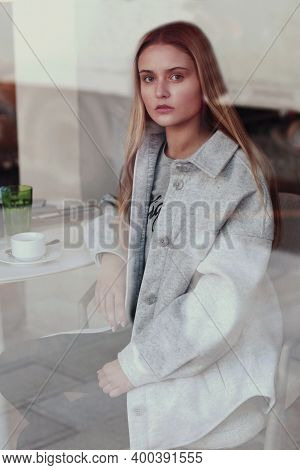 Blond Long Hair Beautiful Girl With Cup Of Coffee Close Up Portrait