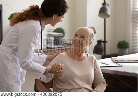 Caring Female Doctor Support Mature Woman Patient