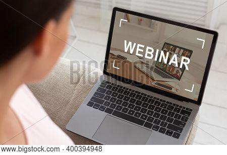 Unrecognizable Caucasian Woman Sitting On Sofa And Watching Webinar, Using Laptop, Home Interior, Cr