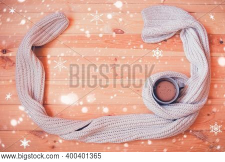 Mug Of Homemade Hot Chocolate Wrapped In Scarf On Wooden Table. Top View, Copy Space.