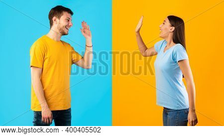Side View Profile Portrait Of Smiling Young Man And Woman Waving To Each Other Or Giving High Five S