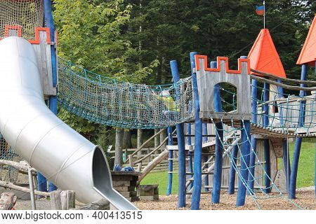 The Child Plays In The Playground. The Child Climbs The Children's Slides. Daylight.