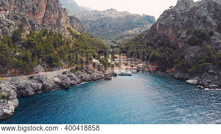 Sa Calobra, Torrent De Pareis Beach With Turquoise Sea Water And Moored Sailing Boats In Crystal Cle