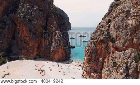 Aerial View Of Small Beach Of Mediterranean Sea, Between Cliffs, Sa Calobra, Torrent De Pareis Beach